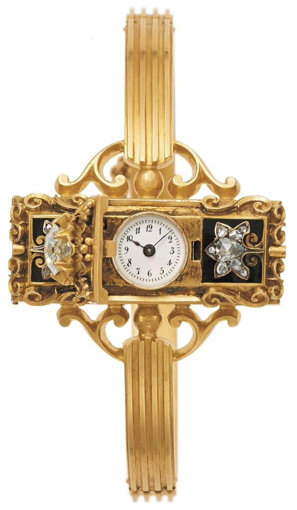 One of the very first wristwatches. Mid 1800s. Decorated gold bracelet watch with elaborate design and small watch face.