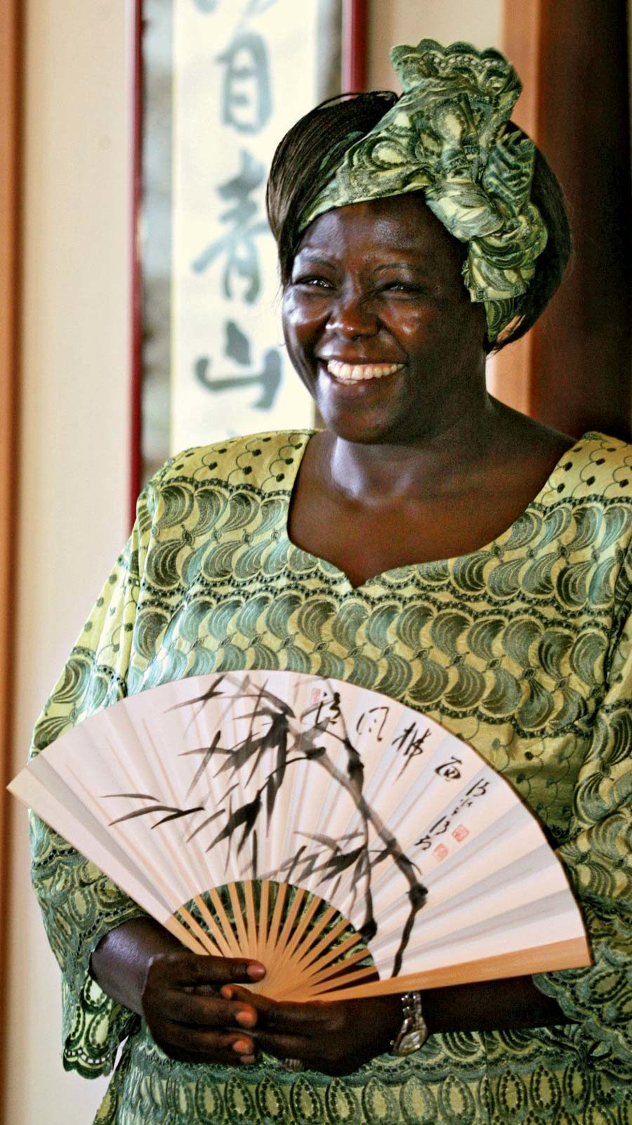 Wangari Maathai in green traditional dress and Japanese Fan