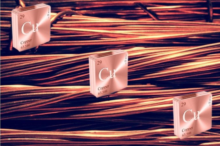 Three Copper Symbols arranged diagonally from top left to bottom right on Bundles of Copper Wire