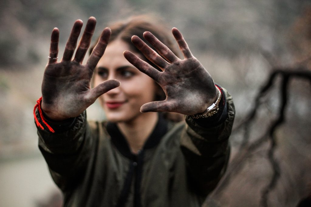 Women holding up charcoal hands