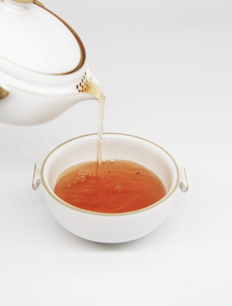 Pouring turmeric tea