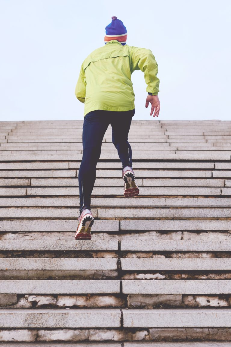 Exercise Motivation- Man running up stairs